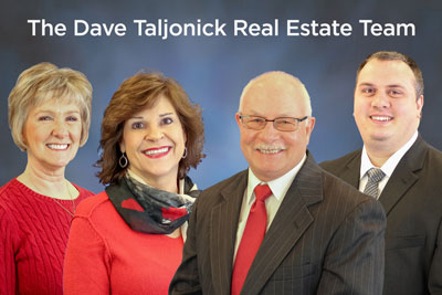 The members of the Dave Taljonick Real Estate Team standing side by side